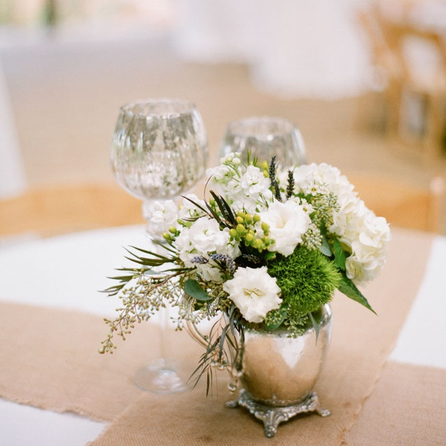 Simple arrangements of lisianthus, lavender, moss, eucalyptus and hydrangeas filled pewter jugs for a rustic chic look.