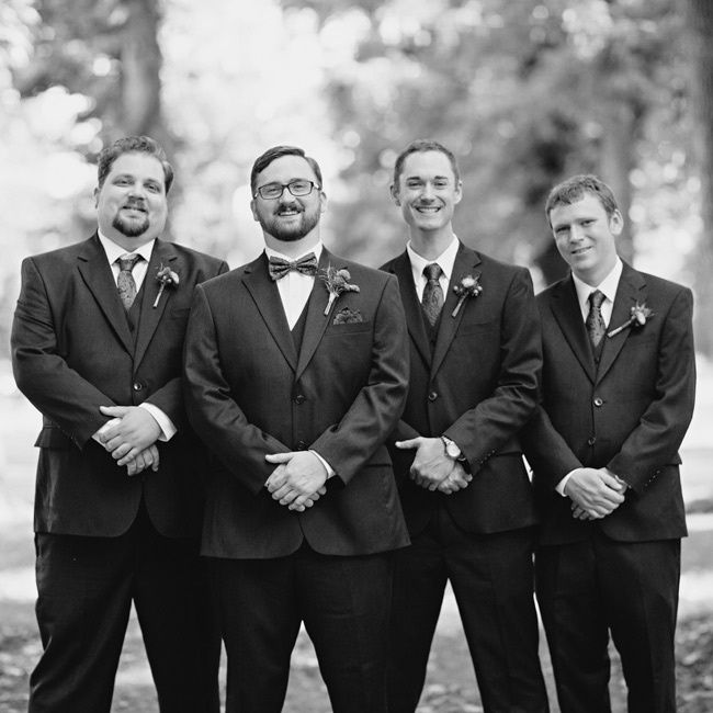 The groomsmen wore three-piece, dark charcoal suits from JoS A. Bank.
