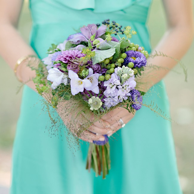 The bridesmaid bouquets were centered around purple dahlias, lavender stock and lavenders freesia, with hypericum berries and kale adding a pop of green.