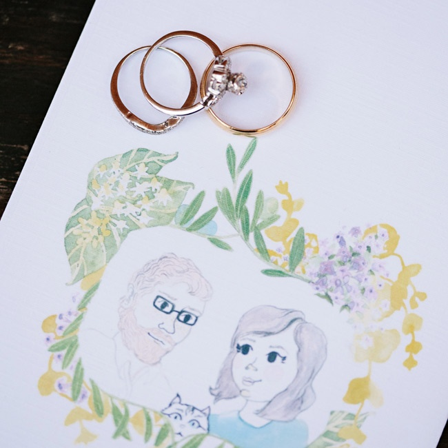 The weddings rings are displayed on top of the couple's thank you notes, which featured a fun watercolor painting of the couple.