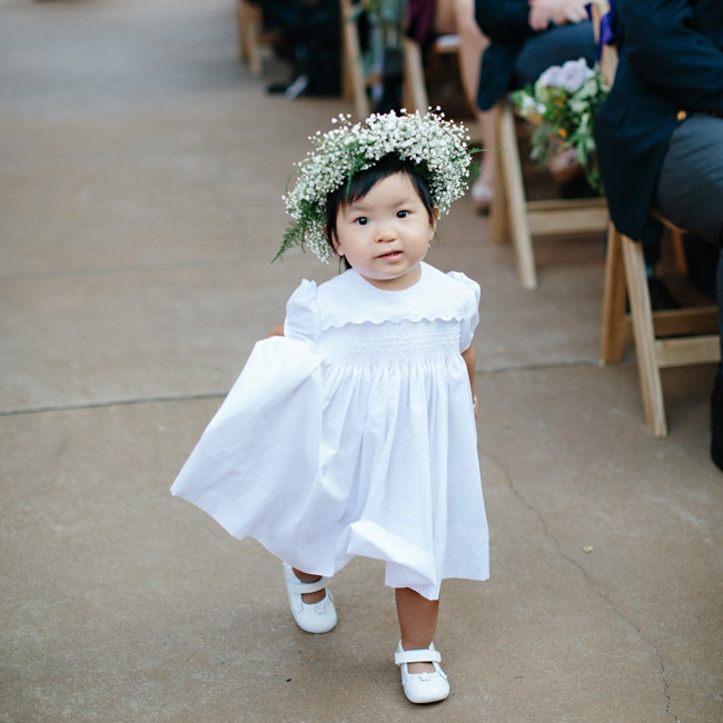 Anna's two-year-old niece, Lottie, was the flower girl. She wore a wreath made of baby's breath in lieu of throwing flower petals.