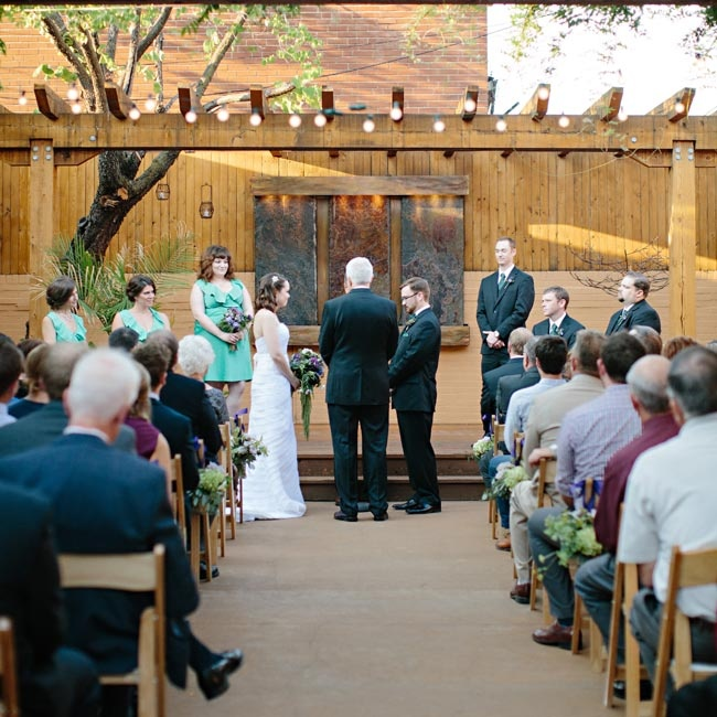 Anna and Nate's outdoor ceremony was held in Oliva on the Hill's small courtyard, beneath a pergola hung with festive cafe lights.