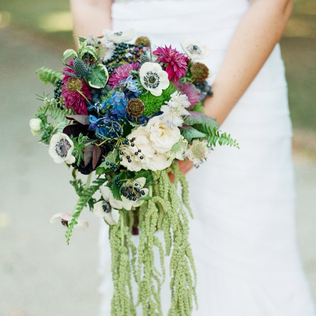 Anna's waterfall bouquet was filled with an assortment of flowers and accented by green hanging amaranthus.