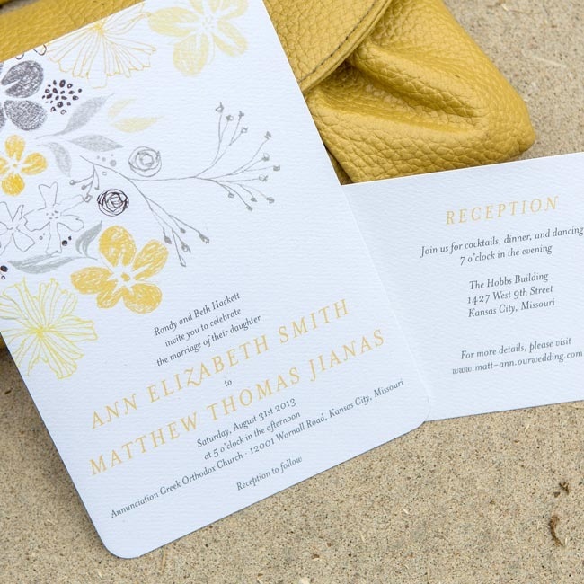 The invitations had a delicate floral pattern, printed in the wedding colors, along the top.