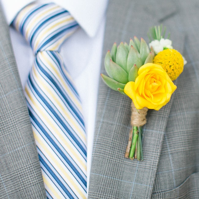 The groomsmen wore cheery boutonnieres made up of yellow roses, billy balls and succulents.