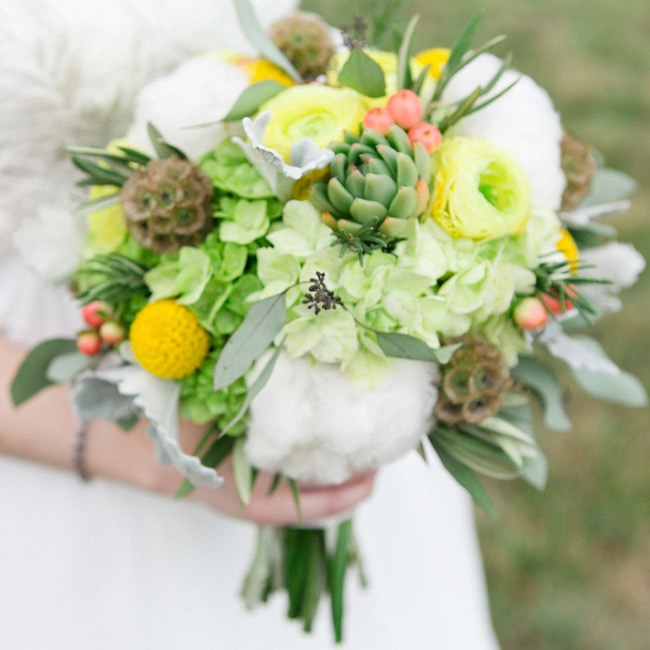 Ann's bridal bouquet featured a mix of cotton bolls, green hydrangeas, succulents, yellow ranunculuses, billy balls and scabiosa pods.