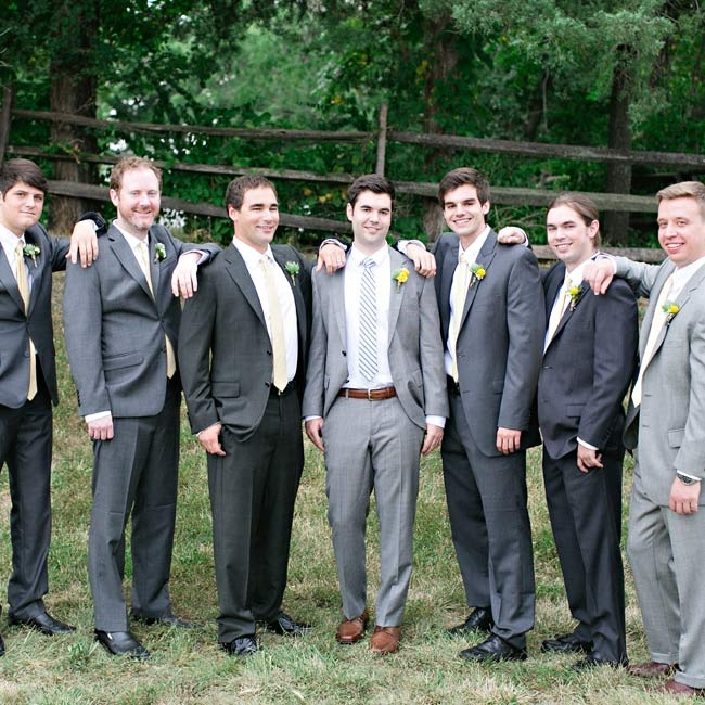 Matt's groomsmen wore their own gray suits, but coordinated their look with matching yellow ties. The groom wore a striped tie for a slightly different look.