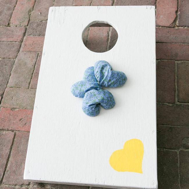Guests were invited to play custom party games during the cocktail hour, including corn hole with heart-shaped bean bags.