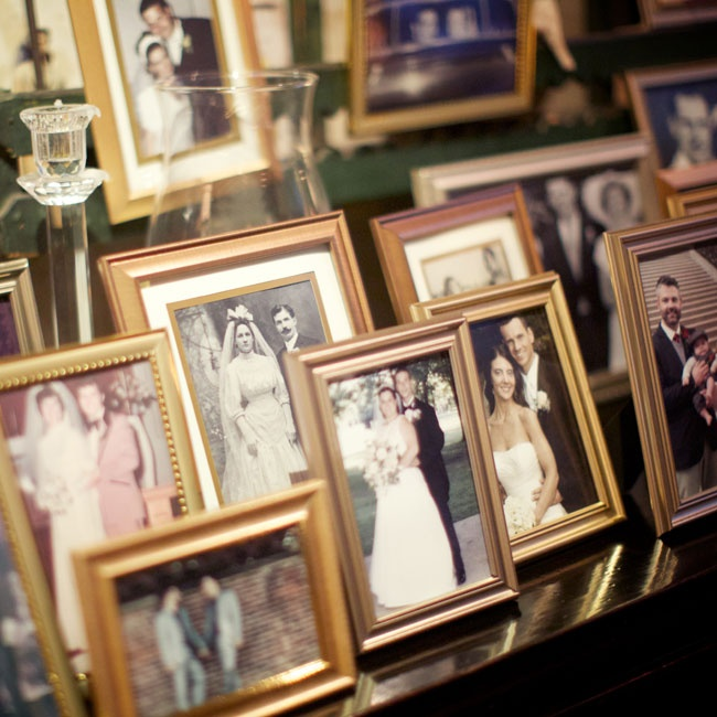 Inspired by an idea from their planner, Pat and Billy asked each of their married guests for a vintage photo of their wedding and placed them in gold frames.