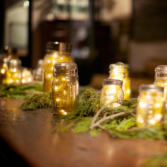 Billy's mom handmade more than 30 mercury glass lanterns out of Mason jars and LED lights. They added a soft glow to the reception.