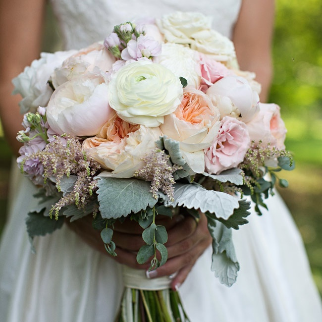 The bridal bouquet was an arrangement of garden roses, peonies, ranunculuses and astilbe flowers in softer, more pastel hues than the bridesmaid bouquets.