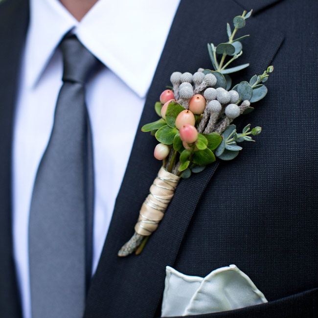 The boutonnieres were made of hypericum and brunia berries for a masculine look.