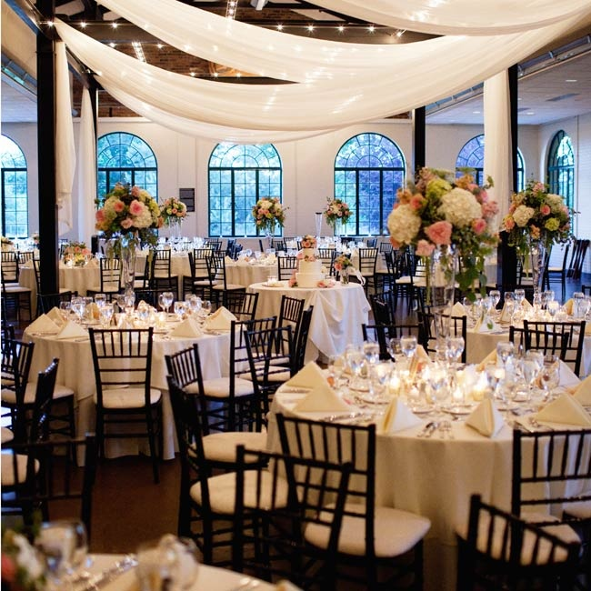 Ivory draping, tablecloths and napkins brought out the classic elegance of the couple's Forest Park reception.