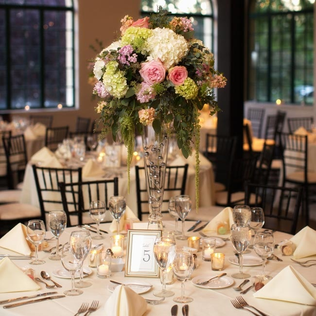 The tables had a mixture of tall and short floral arrangements of roses, hydrangeas and stock in pastel colors.