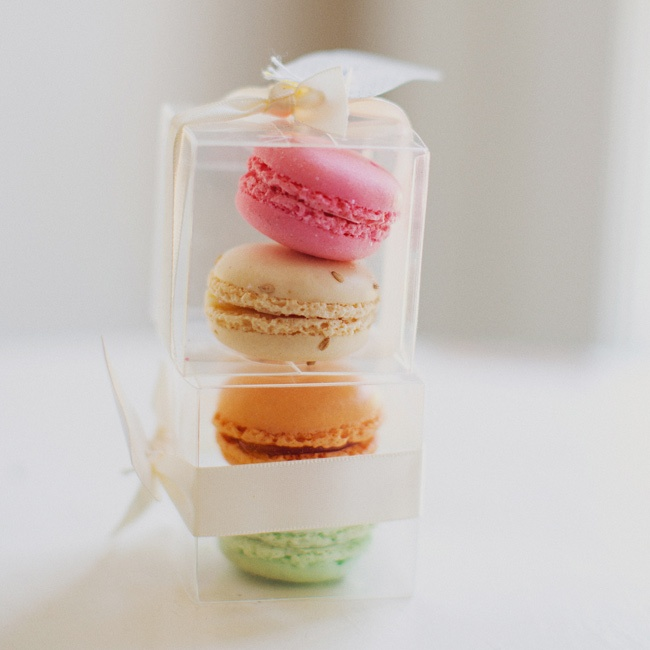 The favors were colorful French macarons, packaged in clear boxes and tied with a ribbon.