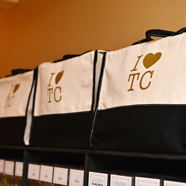 """I [heart] TC"" bags carried all of the guest's goodies wherever they went during the wedding weekend."