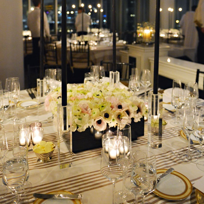 Low, tightly-packed arrangements allowed for unobstructed views -- the modern glass-walled venue overlooked the city and the Hudson River.