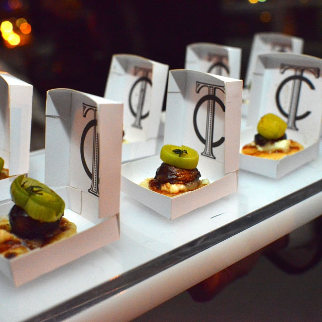 "Guests were served appetizers in ""ring boxes"" with the interlocking logo."