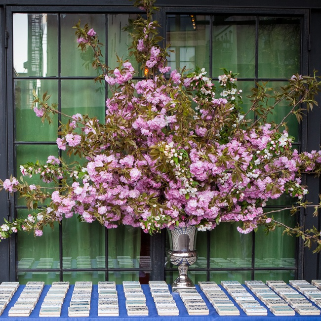 A huge arrangement of cherry blossoms made for an eye-catching escort card display.