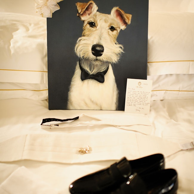 Close friends gave the couple a portrait of their beloved Wire Fox Terrier, Hudson. He was also the inspiration for the favors - custom-made iced sugar cookies in the shape of the pup.