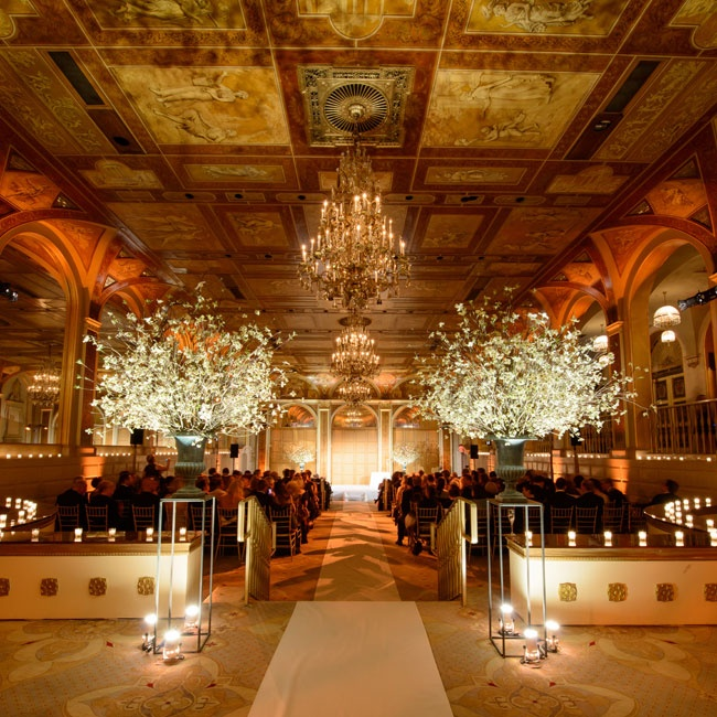 The ceremony was held in the grand Terrace Room at The Plaza Hotel. The couple created a romantic atmosphere with hundreds of votive candles, potted cherry blossom tress and soft lighting from the elegant chandeliers.