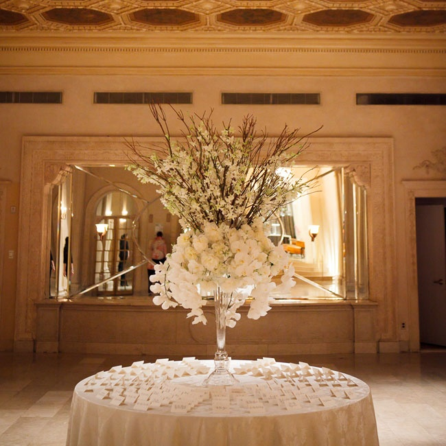 The Plaza's lofty, opulent rooms called for expansive floral arrangements, like cascading orchids, willow branches and delphiniums.