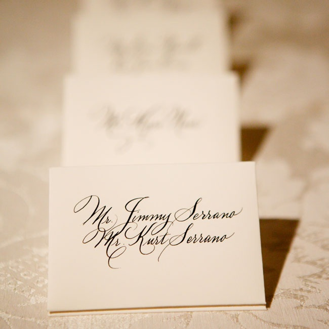 Escort cards were tucked into small envelopes with elegant calligraphy.
