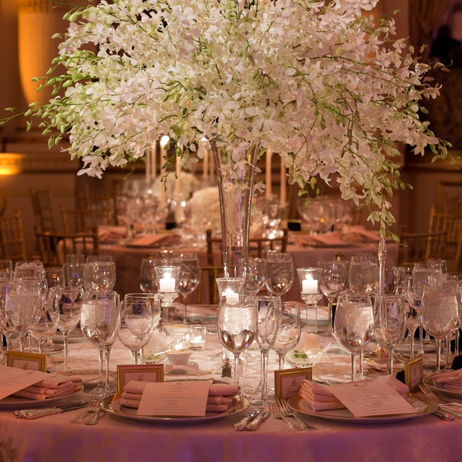 Chic white orchids overflowing in glass vases served as the centerpieces.