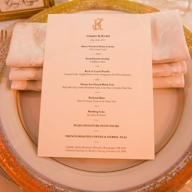 A custom gold monogram adorned the sophisticated menus.
