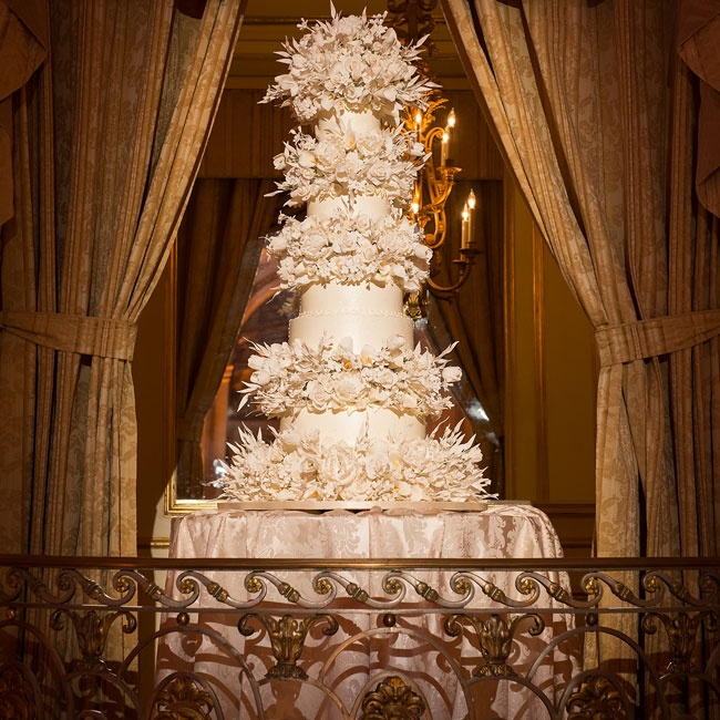 The almost five-foot tall cake from legendary cake designer Slyvia Weinstock was decked out in expertly made sugar flowers.