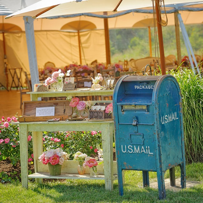 "At the sign-in table, guests wrote well-wishes on pre-stamped vintage postcards and ""mailed"" them in the rented postbox."