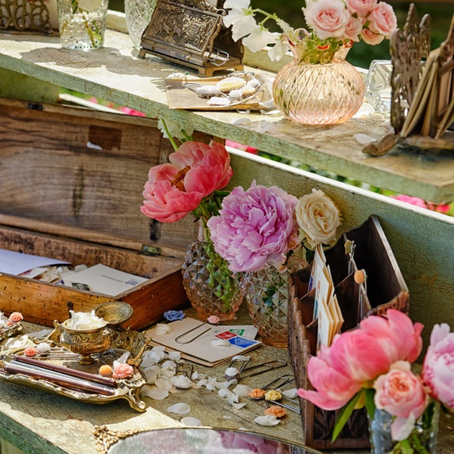 Antique vases, trays and letter holders brought a old-world sophistication to the rustic decor.
