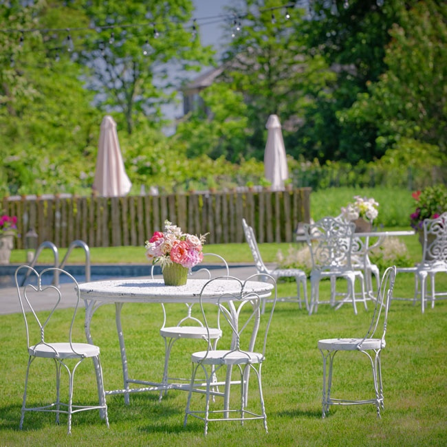 For the cocktail hour, Kim and Lexi set up vintage garden furniture throughout  the yard where guests could kick back and relax.