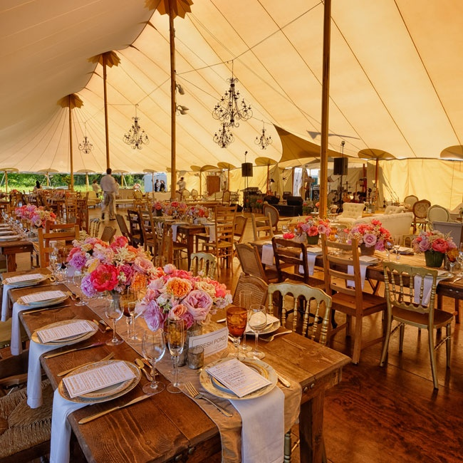Long wooden farm tables, elegant chandeliers and a tent made from sails came together for a sophisticated, rustic chic look.