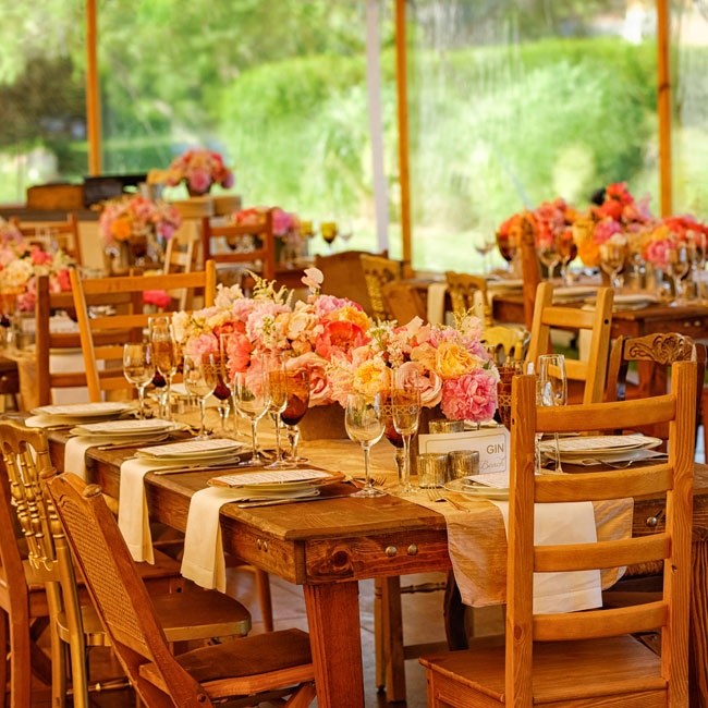 Mix-and-match chairs surrounded long farm tables that were covered in interesting textures - silk table runners, gold-rimmed china, etched glass and lush blooms.