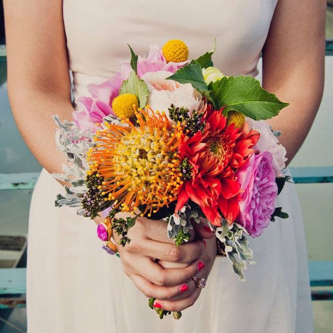 Andrea carried a bright textured bouquet filled with protea, billy balls, garden roses and mums.