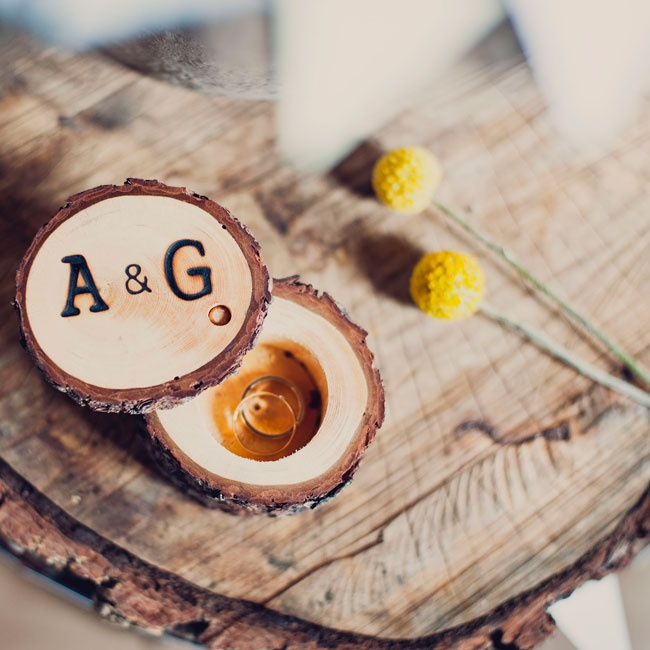 The rings were held in a small wooden ring box made from a tree branch. The couple's initials were engraved in the top of the box. During the ceremony, they initiated a ring-passing where each guest  was able to hold the box with the rings for a few moments and wish the newlyweds well.