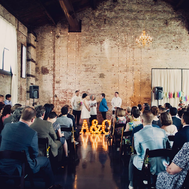 The Green Building in Brooklyn, where Andrea and Grace had their ceremony and reception, is a unique raw space with exposed brick wall and soaring exposed beam ceilings with elegant chandeliers. former brass foundry that has been transformed. The couple decorated the industrial chic space with playful touches like marquee lights, bright colors and  ...