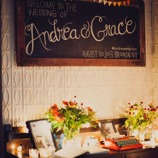 Colorful, quirky floral arrangements and a cherry red typewriter gave the entry table a fun, fresh touch. Bright pennants and a big, scrolling typeface personalized a weathered old chalkboard.