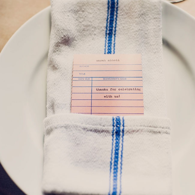 Self-proclaimed book nerds, the couple used library catalog cards as place cards.