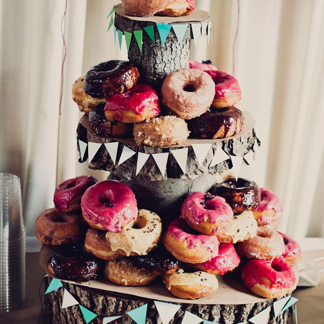 A selection of doughnuts from Dough sat on a tree-stump stand handcrafted by a friend.