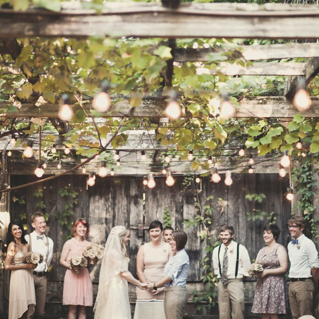Kat and Meredith exchanged vows under a huge trellis covered in grape vines. Bistro lights added a fun whimsical touch.