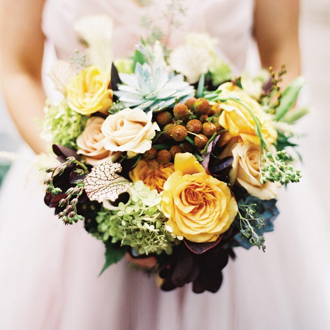 """I carried a lush bouquet of flowers in shades of blush, ivory, gray, yellow and green. Flowers included hydrangea, dahlias, stock, craspedia and succulents,"" Sydney says."