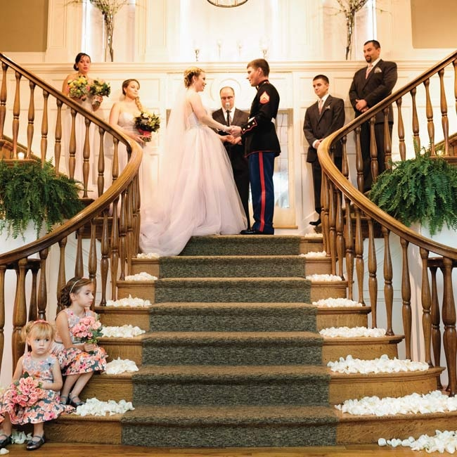Because of rain, the outdoor ceremony had to be moved indoors on the grand staircase of The Pittsburgh Center for the Arts.