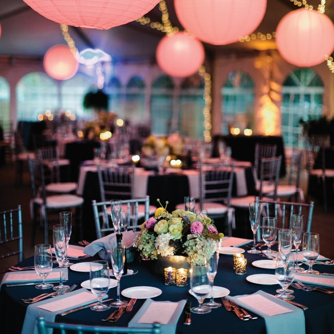 The reception took place under a tent with twinkle lighting and blush lanterns giving the entire space a romantic glow.