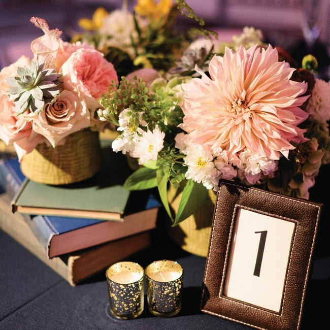 Tables had a trio of mustard yellow ceramics elevated by books containing green eye roses, hydrangea, succulents, craspedia and dahlias.