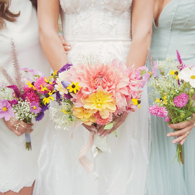 Maria and her bridesmaids carried hand-tied bunches of colorful wildflowers.