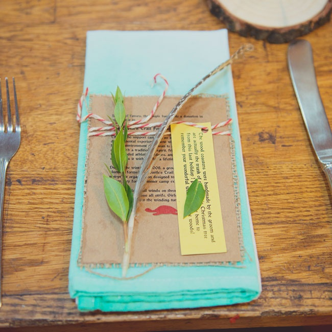 In lieu of gifts, the couple made a donation to the Turtle's Trail foundation, a non-profit organization that raises money to send underprivileged girls to summer camp. The couple placed the cards at each setting along with a single feather and sprig of green leaves.