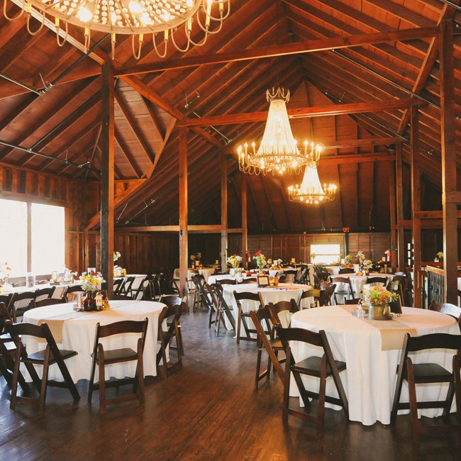 Gorgeous chandeliers hung from the rafters of the barn, giving the wood walls and floor an even warmer feel.