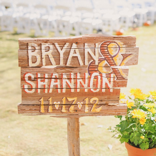 A sweet sign hand-painted with the couple's names and wedding date greeted guests at the entrance to the farm.
